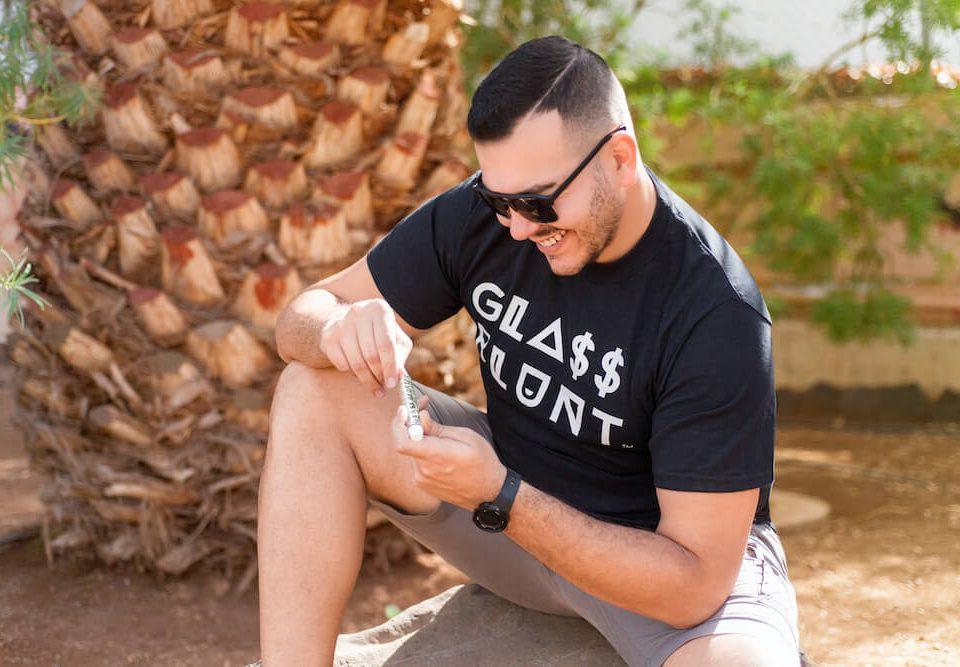 Man holding glass blunt