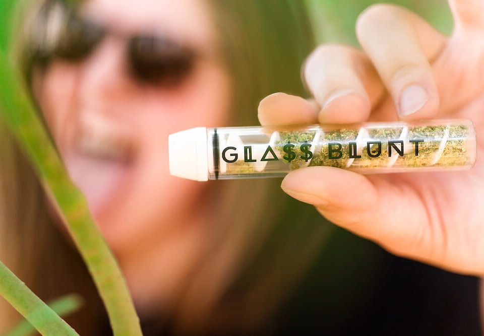 holding glass blunt
