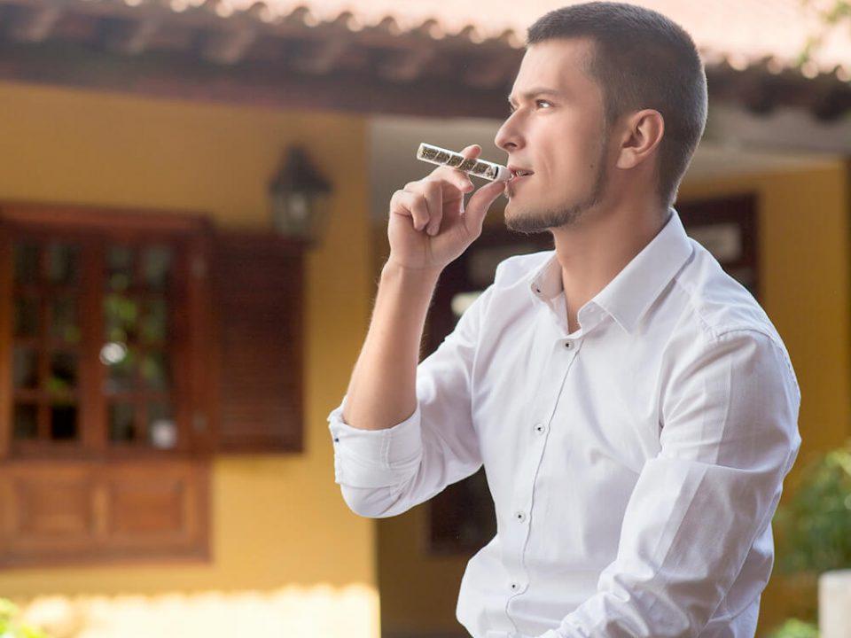 Man smoking glass blunt